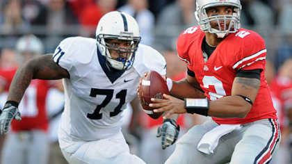Ohio State quarterback Terrelle Pryor drops back to pass as Penn State&#039;s Devon Still closes in in the second quarter.