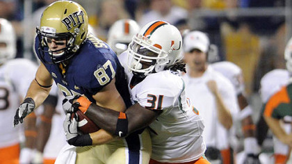 Pitt's Mike Shanahan is taken down by Miami's Sean Spence in a 2010 game. The Steelers chose Spence in the third round of the NFL draft.
