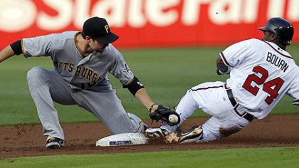Atlanta Braves center fielder Michael Bourn is tagged out by  Pirates second baseman Neil Walker (18) as he attempts to steal second base in the first inning)