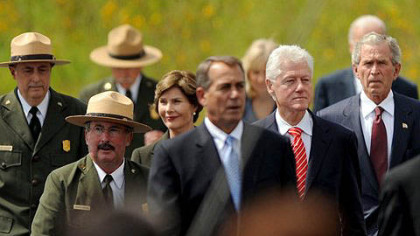 Former first lady Laura Bush walks behind Speaker of the House John Boehner with former president Bill Clinton and former president George Bush at the Flight 93 National Memorial Dedication on Sept. 10, 2011, in Stoneycreek Township near Shanksville, Somerset County.