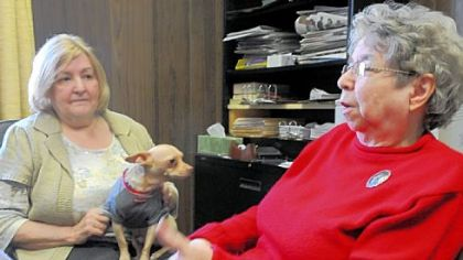 Charlene Word, left, and Georgia Boring, who are sisters, still run the Penn-Franklin News started by their father in 1947, sometimes with the help of Willie the chihuahua, Mrs. Word's office pet.