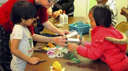 Joann Kielar, artist in residence, teaches children and their parents how to make puppets at South Hills Interfaith Ministries family center in the Whitehall Place apartments in Whitehall.