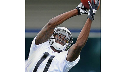 Toney Clemons goes up for a pass on Day 2 of rookie orientation camp.
