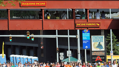 Runners stream along West Carson Street past the Duquesne Incline.