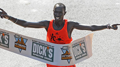Claiming the gold cup in the men's division was James Kirwa of Kenya with a time of 2:14:09.