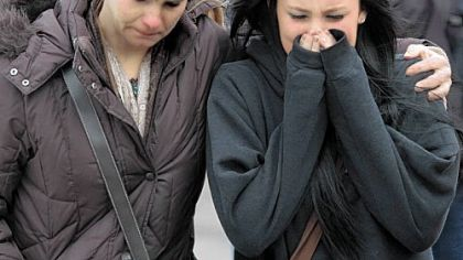 A distraught Ava Polaski, a sophomore, leaves school grounds Monday with her mother, Misty Polaski, following the school shooting in Chardon, Ohio.