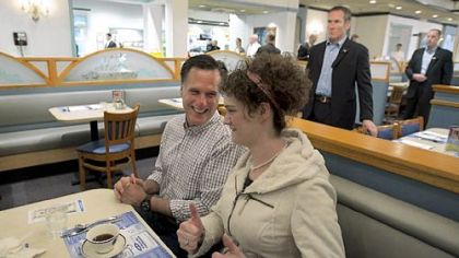 Former Massachusetts Gov. Mitt Romney gets two thumbs up from a supporter in Fond du Lac, Wis., as Secret Service agents look on Friday.