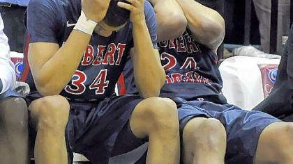 A dream denied, Robert Morris' Russell Johnson and Lawrence Bridges wait out the final seconds in Brooklyn.