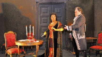 "Tosca (Angela Brown) seizes an opportunity -- and a knife -- to end Scarpia's (Mark Delavan) tyranny in ""Tosca."""