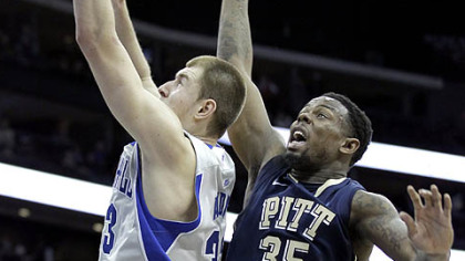 Seton Hall's Patrik Auda, left, goes up for a shot against Pitt's Nasir Robinson during the first half in Newark, N.J.