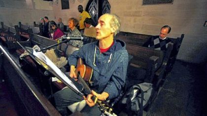Richard Kobertz play guitar every week as part of the live musicans of Tazie Prayer at East Liberty Presbyterian Church.