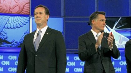 Republican rivals Rick Santorum, left, and Mitt Romney await the start of Wednesday's debate in Mesa, Ariz.