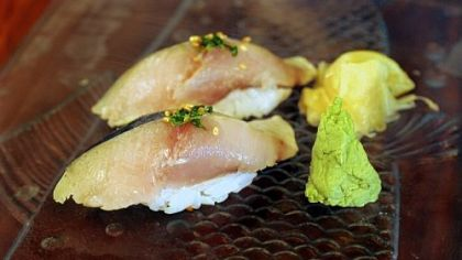 Spanish mackerel nigiri with pickled ginger and wasabi.