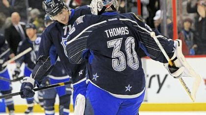 Team Chara's Evgeni Malkin and goaltender Tim Thomas celebrate their 12-9 victory Sunday against Team Alfredsson in the NHL All-Star Game in Ottawa, Ontario. Will Malkin finish the second half of the season as the league leader in points for his second Art Ross trophy?