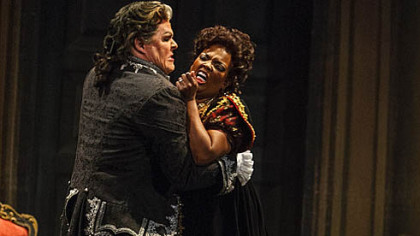 "Anglea Brown as Tosca ""has a luscious, full-bodied sound ... the fire and ice of a genuine diva."" Mark Delavan as Scarpia is ""suave and menacing"" with a ""booming baritone"" that ""makes the right dramatic points."""