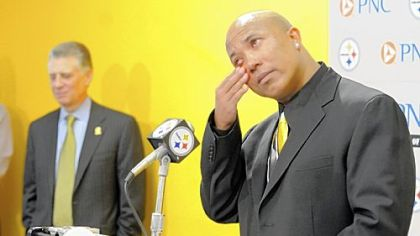 A tearful Hines Ward speaks at a press conference Tuesday at the Steelers offices on the South Side announcing his retirement from football. Steelers President Art Rooney stands in the background.