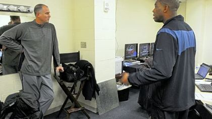 Bilas, left, and Hubert Davis confer in the production room in anticipation of the next day's telecast.