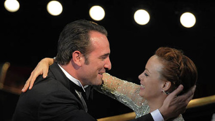 "Jean Dujardin is congratulated by Berenice Bejo before accepting the Oscar for best actor for ""The Artist."""