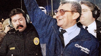 In this Jan. 2, 1995 file photo, Penn State head coach Joe Paterno smiles as he celebrates his team's victory over the University of Oregon in the Rose Bowl college game in Pasadena, Calif.