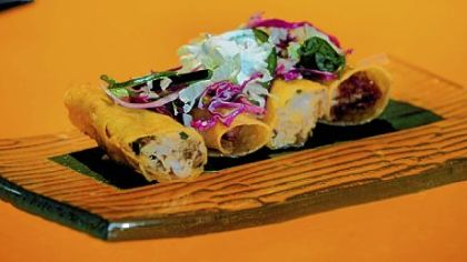 The smoked chicken flautas with their crispy tortillas and crunchy cabbage salad at Verde Mexican Kitchen.
