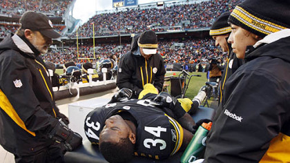 Rashard Mendenhall is examined on the sideline after an injury in the first half of the game against the Cleveland Browns.