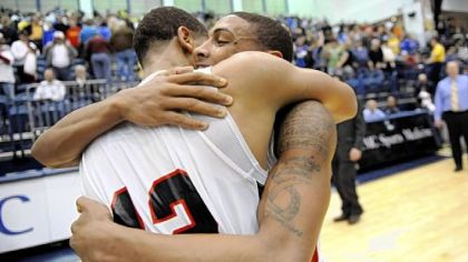 New Castle&#039;s Shawn Anderson hugs teammate Corey Eggleston after defeating Hampton in the WPIAL Class AAA championship Friday at the Palumbo Center.