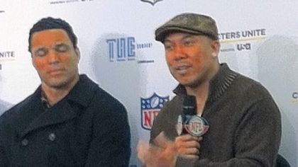 Steelers receiver Hines Ward, seated next to Atlanta tight end Tony Gonzalez, speaks about his role in mentoring a Clairton High School student at a news conference Thursday at the J.W. Marriott in Indianapolis.