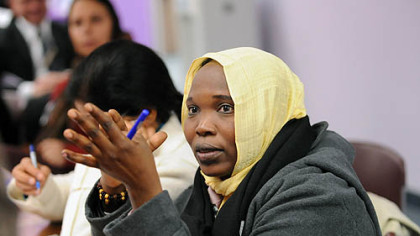 Hawa Abdallah Mohammed Salih, a human rights activist from Sudan, asks a question during a talk and reception for International Women of Courage awardees at Gwen's Girls in Point Breeze.