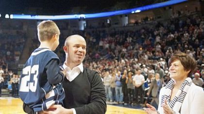 Penn State's new football coach Bill O'Brien is introduced with his son, Michael, 6, and wife, Colleen, during the first half of the Nittany Lions basketball game Sunday against Indiana.