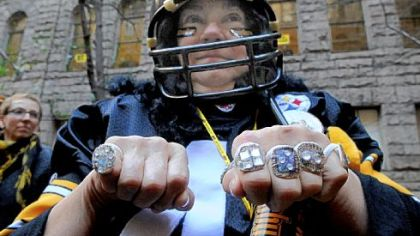 Marlene Campen of Plum shows off her homemade  championship rings Friday during the Steelers rally at the Allegheny County Courthouse, Downtown.