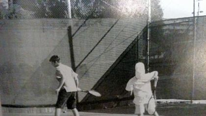 John Shick, left, warms up with a teammate on Long Beach Polytechnic High School's tennis squad. Photo from the school's 1999 yearbook.