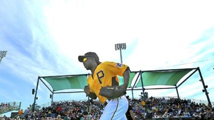 Andrew McCutchen runs on to the field for the Pirates home exhibition opener Sunday at McKechnie Field in Bradenton, Fla.