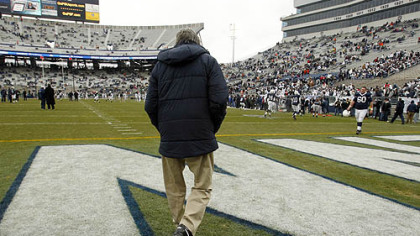 In this Nov. 27, 2010, file photo, Penn State coach Joe Paterno walks on to the field at Beaver Stadium for warm ups before a game against Michigan State.
