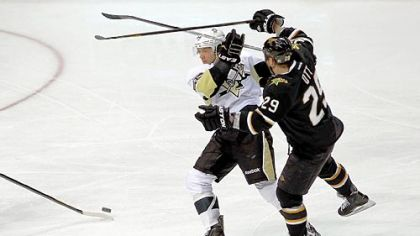 Kris Letang tangles Wednesday with Dallas&#039; Steve Ott. Letang is suffering from concussion symptoms after a hit from forward Eric Nystrom later in the game.