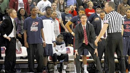 Robert Morris coach Andy Toole looks to the referee after no foul was called on a hit that landed Lucky Jones on the floor Wednesday night against Long Island in Brooklyn.