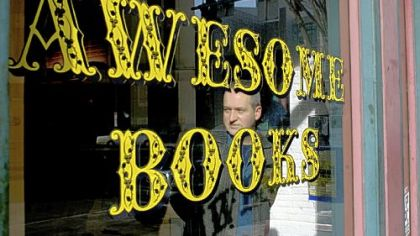 Co-owner Bob Ziller in the window of his new bookstore, Awesome Books, at 929 Liberty Ave., Downtown.
