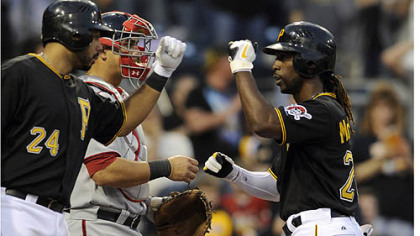 Andrew McCutchen is congratulated by Pedro Alvarez after hitting his first home run of the season.