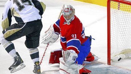 Canadiens goalie Carey Price makes a save against Penguins center Dustin Jeffrey in the first period Tuesday in Montreal.