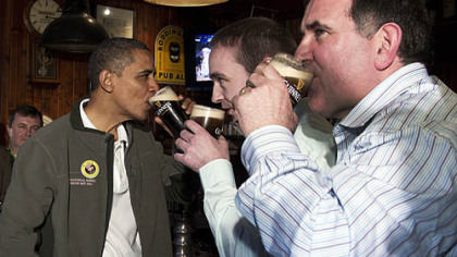 President Barack Obama drinks a Guinness Saturday with his ancestral cousin from Moneygall, Ireland, Henry Healy, center, and the owner of a pub there, Ollie Hayes, at The Dubliner Restaurant and Pub in Washington on St. Patrick&#039;s Day.