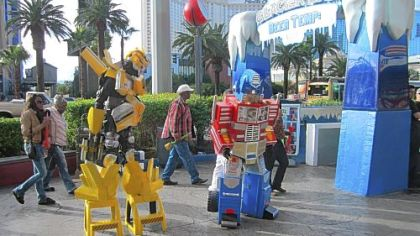 Entertainers dressed as pop culture characters -- here they are Transformers -- troll for tips on the Strip.