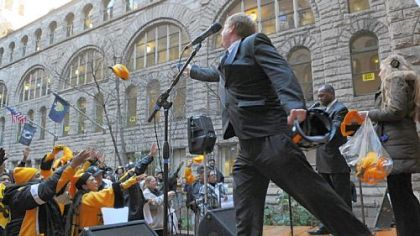 Allegheny County Executive Rich Fitzgerald throws Terrible Towels and other Steelers items to the crowd during the rally Friday at the Allegheny County Courthouse, Downtown.