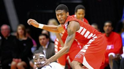 A loose ball eludes Robert Morris' Velton Jones, left, and Saint Francis' Earl Brown Saturday.