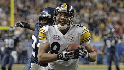 Hines Ward flashes his trademark smile while scoring a touchdown for the Steelers in Super Bowl XL. The score clinched the championship for the Steelers and the game MVP award for Ward.