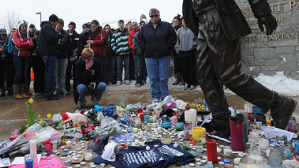 Mourners gather at the Joe Paterno statue outside Beaver Stadium in State College where a makeshift memorial has been set up.