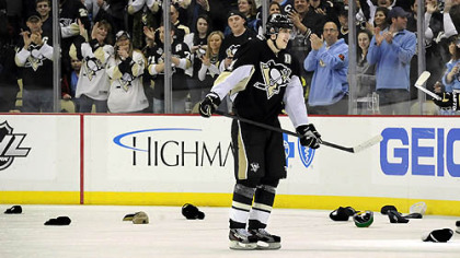 Evgeni Malkin skates through the shower of hats that littered the ice after he scored his third goal Saturday in the Penguins&#039; 8-1 rout of Tampa Bay at Consol Energy Center.