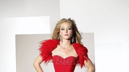 Gown with feathered shrug by Alyce.