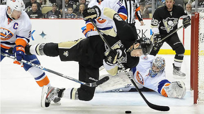 Islanders Evgeni Nabokov makes a diving save on  Pascal Dupuis in the third period.