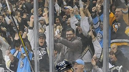 Evgeni Malkin celebrates Friday after scoring the shootout winner against the Canadiens.