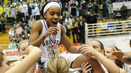 Hopewell's Jharrin Gill is lifted by her teammates after the Vikings defeated South Park for the Class AAA title Saturday.