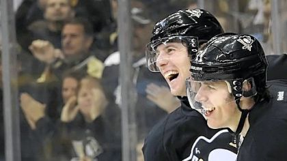 James Neal congratulates teammate Evgeni Malkin after scoring the winning goal in overtime against the Capitals Sunday at Consol Energy Center.